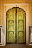 Wooden old ornamented door vintage background — Stock Photo