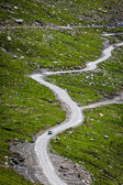 Serpentine road in Himalayas mountains — Stock Photo