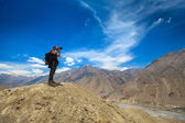 Photographer taking photos in Himalayas — Stock Photo