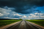 Road and stormy sky — Stock Photo