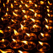 Stock Photo: Candles in Buddhist temple