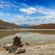 Stock Photo: Trekking hiking boots at mountain lake