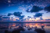 Sunset on Baga beach. Goa — Stock Photo
