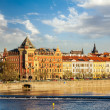 Постер, плакат: Prague Stare Mesto embankment view from Charles bridge