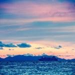 Sea sunset with criuse ship — Stock Photo