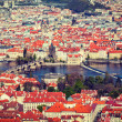 View of Charles Bridge over Vltava river and Old city — Stock Photo #45096607