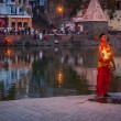 Brahmin performing Aarti pooja ceremony on bank of river Kshipra — Stock Photo #45097095