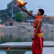 Brahmin performing Aarti pooja ceremony on bank of river Kshipra — Stock Photo #45097123