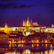 View of Charles Bridge and Prague Castle in twilight — Stock Photo #45097441