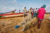 Indian fishermen dragging fishing net — Stock Photo