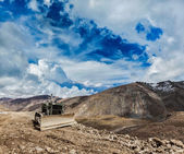 Bulldozer on road in Himalayas — Stock Photo