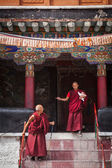Tibetan Buddhist monks ascending the stairs in Spituk monastery — Stock Photo