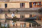 Unidentified indian man in small boat — Stock Photo