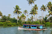 Unidentified indian people in small boat — Stock Photo
