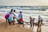 Indian fishermen dragging fishing net — Stock Photo