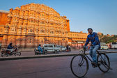 Unidentified Indian man driving bicycle in front of  Hawa Mahal  — Stock Photo