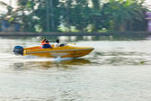 Unidentified foreing tourists in speed boat — Stock Photo