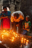 Unidentified Indian family father mother son worshipping — Stock Photo