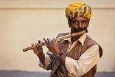 Indian man plays wooden flute in Mehrangarh fort — Stock Photo