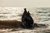 Group of Indian fishermen going into the sea — Stock Photo