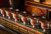 Offerings (Tibetan Water Offering Bowls) in Lamayuru gompa — Stock Photo