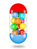 Vitamins in capsule — Stock Photo