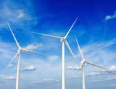 Wind generator turbines in sky — Stock Photo