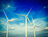 Wind generator turbines in sky — Foto Stock