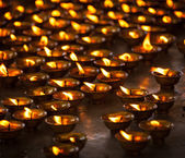 Burning candles in Buddhist temple — Stock Photo