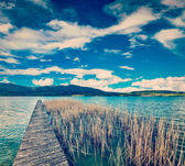 Pier in lake in countryside — Stock Photo