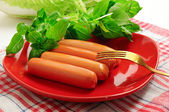 Sausage with green vegetables — Stock Photo