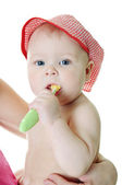 Little baby girl with teething brush — Stock Photo