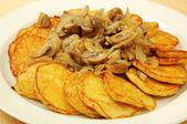 Potato pancakes with mushrooms — Stock Photo