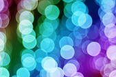 Christmas rainbow bokeh — Stock Photo