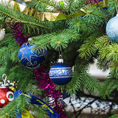 Christmas decorations on the fir tree — Stock Photo