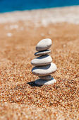 Cairn on the sand — Stock Photo