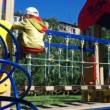 Cute little boy playing in a children playground . — Stock Video #12265367