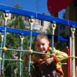 Cute little boy playing in a children playground . — Stock Video #12265809