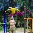 Cute little boy playing in a children playground — Stock Video #12266019