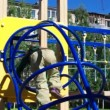 Cute little boy playing in a children playground . — Stock Video #12267500