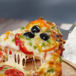Taking slice of pizza,melted cheese dripping — Stock Photo