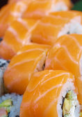 Roll made of salmon — Stock Photo