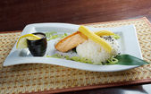Salmon in cream sauce — Stock Photo