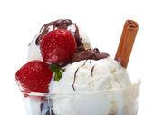 Ice cream with chocolate sauce and strawberries,cinnamo — Stock Photo