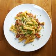 Italian Penne rigate pasta with - Stock Photo