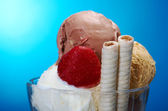 Ice cream in with strawberries and chocolate — Stock Photo