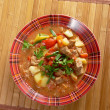 L Hungarian hot goulash soup - Stock Photo