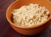 Bowl with fresh porridge — Stock Photo