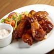 Roasted chicken wings on plate — Stock Photo