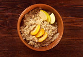 Oat porridge with fruit — Stock Photo